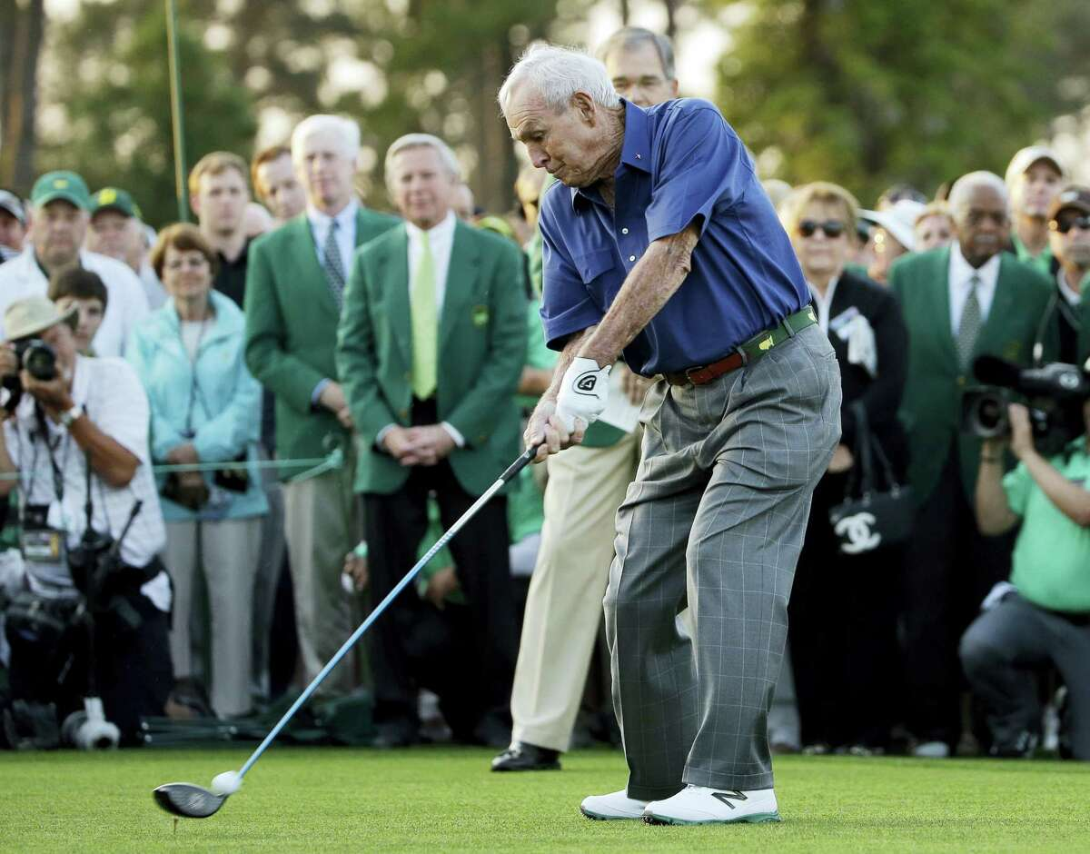 In this 2015 file photo, Arnold Palmer hits an honorary tee shot before the first round of the Masters. Palmer will be on the first tee to help start the Masters this year — but without his golf clubs. Palmer said Tuesday that he has told Augusta National he will not be hitting the ceremonial tee shot to start the Masters this year.