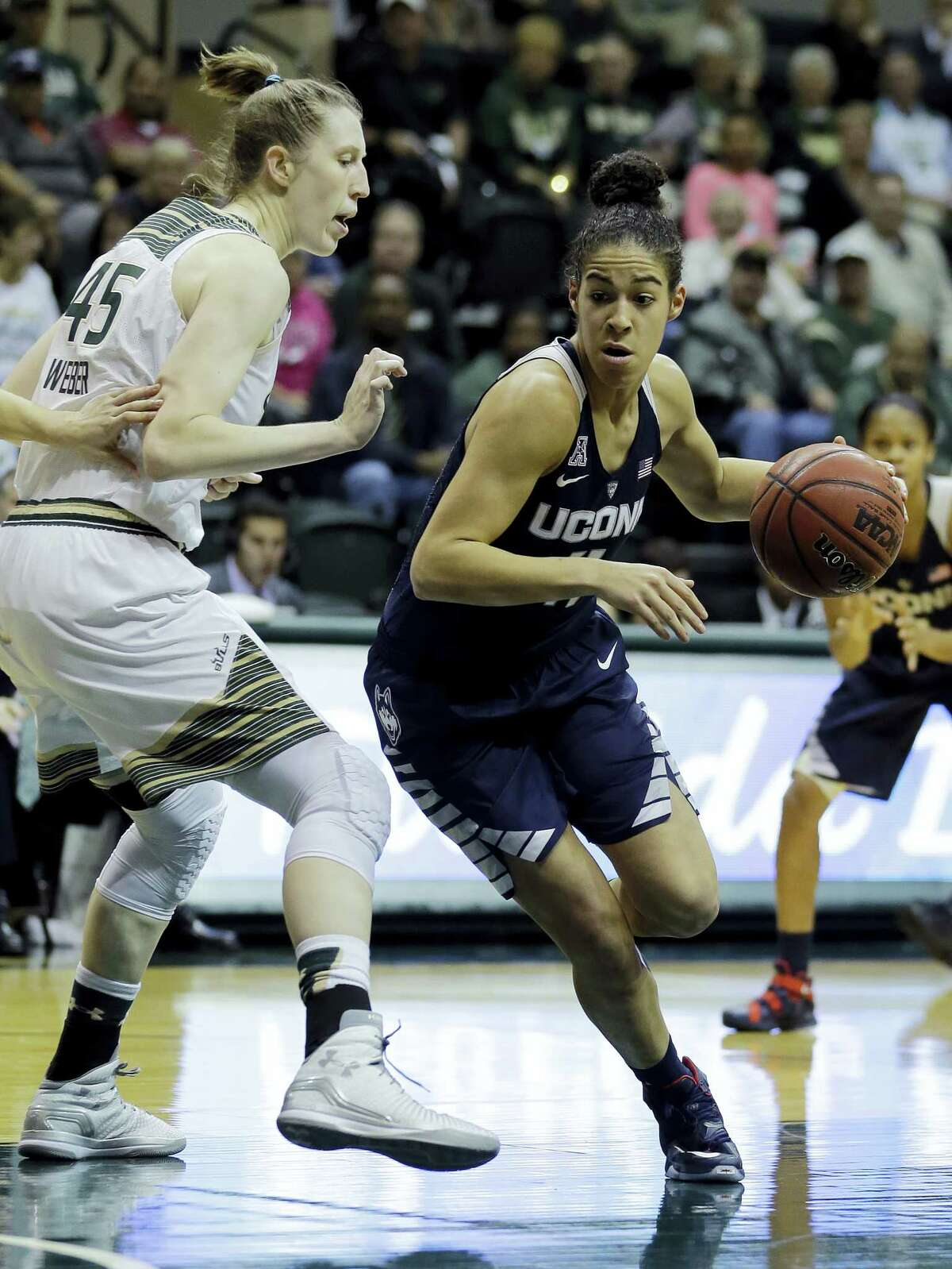 Connecticut guard Kia Nurse (11) drives around South Florida center Katelyn Weber (45) during the first half of an NCAA women's college basketball game Sunday, Jan. 10, 2016, in Tampa, Fla. (AP Photo/Chris O'Meara)
