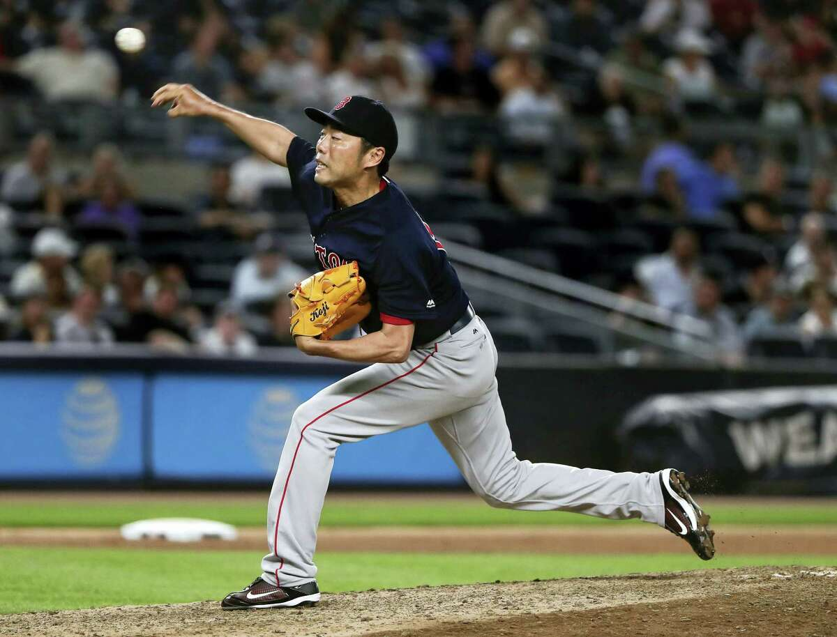 Koji Uehara delivers against the Yankees during the ninth inning on Friday.