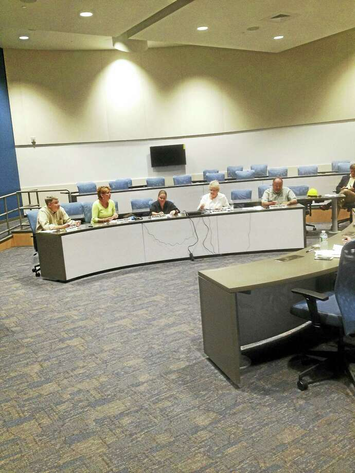 The East Hampton High School Building Committee met on Thursday in the new building's team-based teacher learning laboratory. Photo: Jeff Mill — The Middletown Press