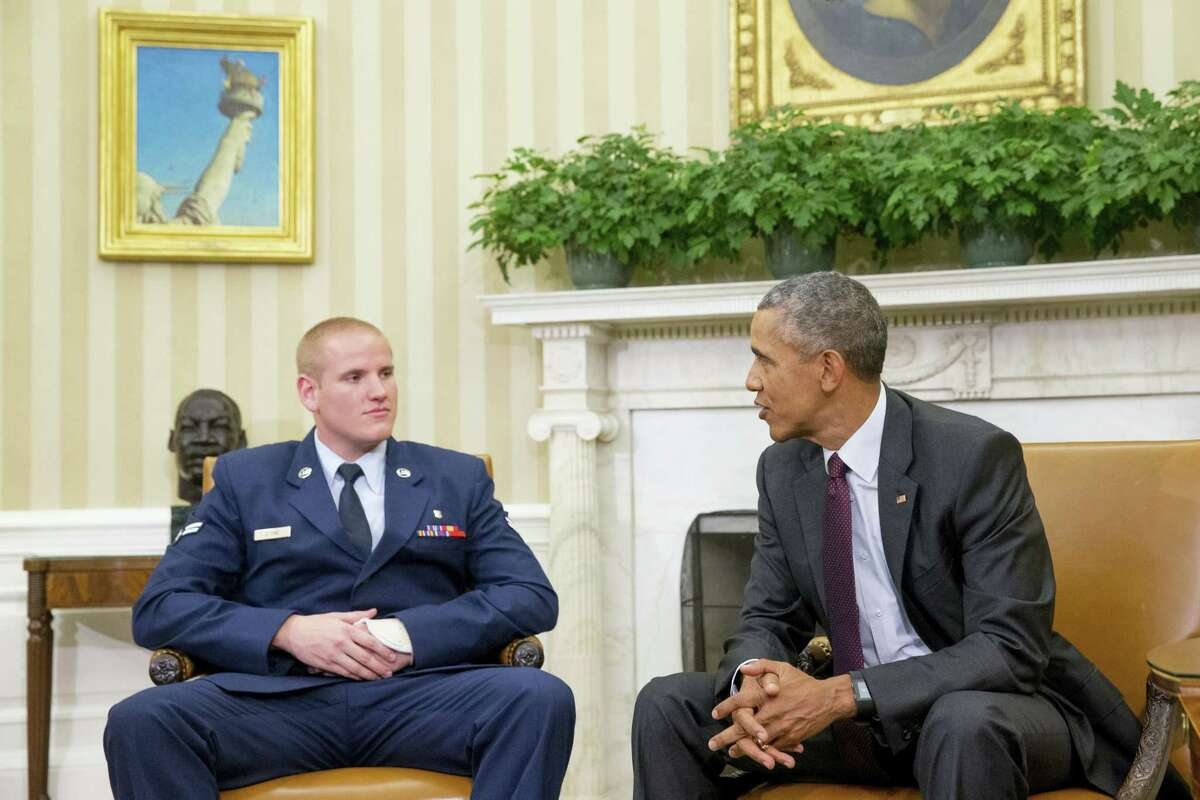 In this Sept. 17, 2015, file photo, President Barack Obama speaks to Air Force Airman 1st Class Spencer Stone in the Oval Office of the White House in Washington. Stone, one of three Americans to thwart a terrorist attack on a Paris-bound train, will be a guest of First Lady Michelle Obama at the State of the Union. Staff Sgt. Spencer Stone told The Associated Press, Monday, Jan. 11, 2016, that attending Tuesday's presidential address will be the highlight of the revelry that followed the thwarted train attack.