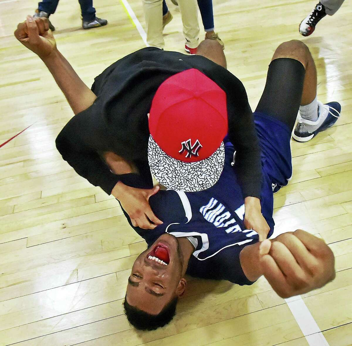 Middletown's Makai Hunter celebrates with a classmate following Tuesday's win.