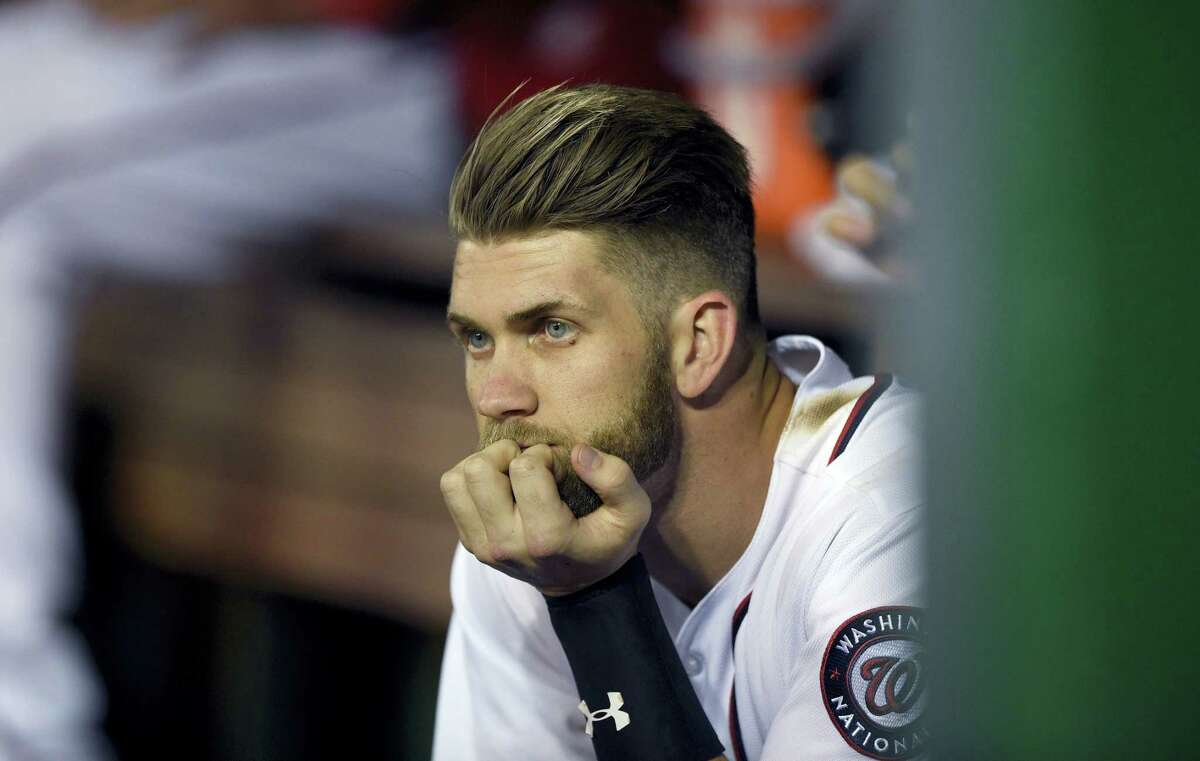 Washington Nationals' Bryce Harper looks on from the dugout.