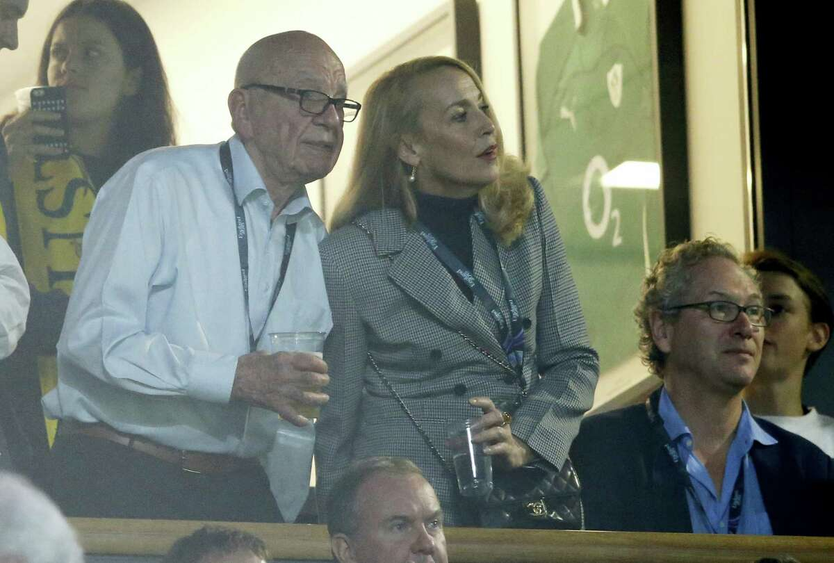 In this Nov. 1, 2015, file photo, media mogul Rupert Murdoch stands with model Jerry Hall during the Rugby World Cup final between New Zealand and Australia at Twickenham Stadium, London. Murdoch has announced his engagement to Hall, the actress and former supermodel who had a long-time relationship with Mick Jagger, Monday, Jan. 11, 2016.