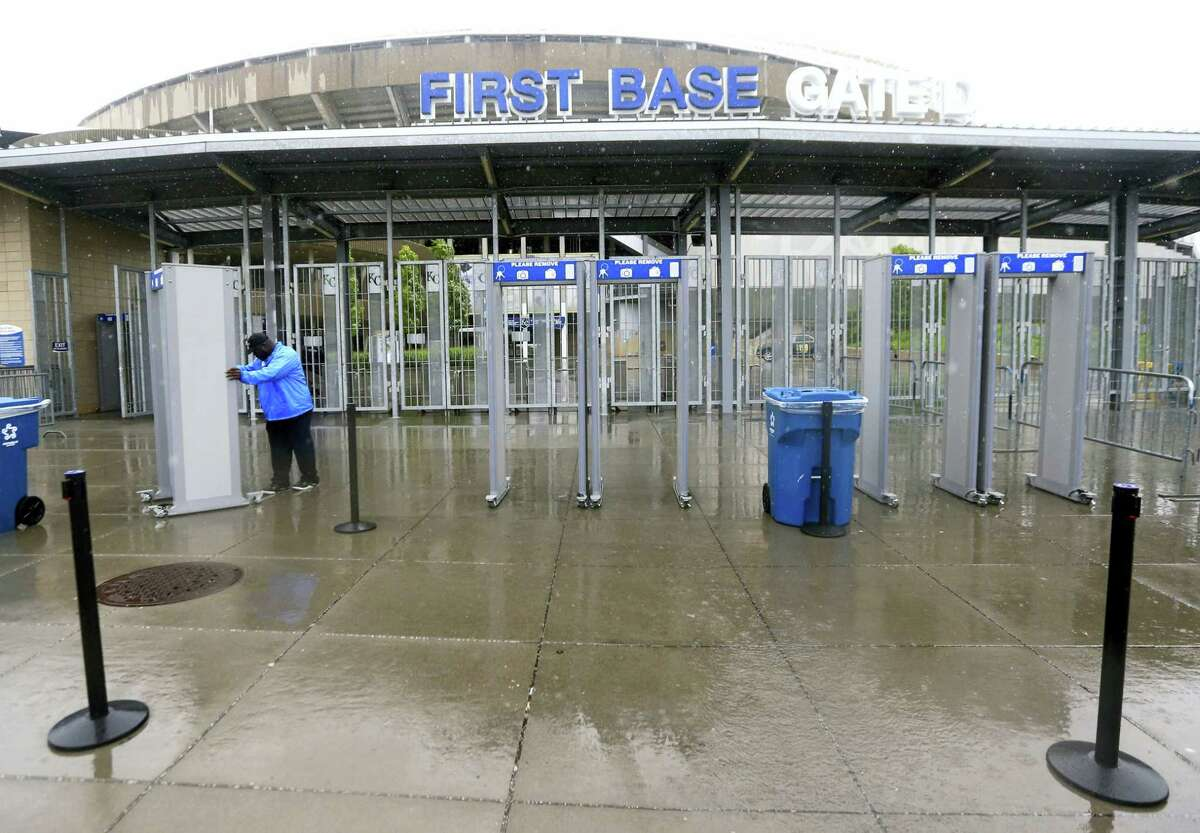 A security workers puts away screening equipment after Monday's game between the Red Sox and Royals was postponed at Kauffman Stadium in Kansas City.