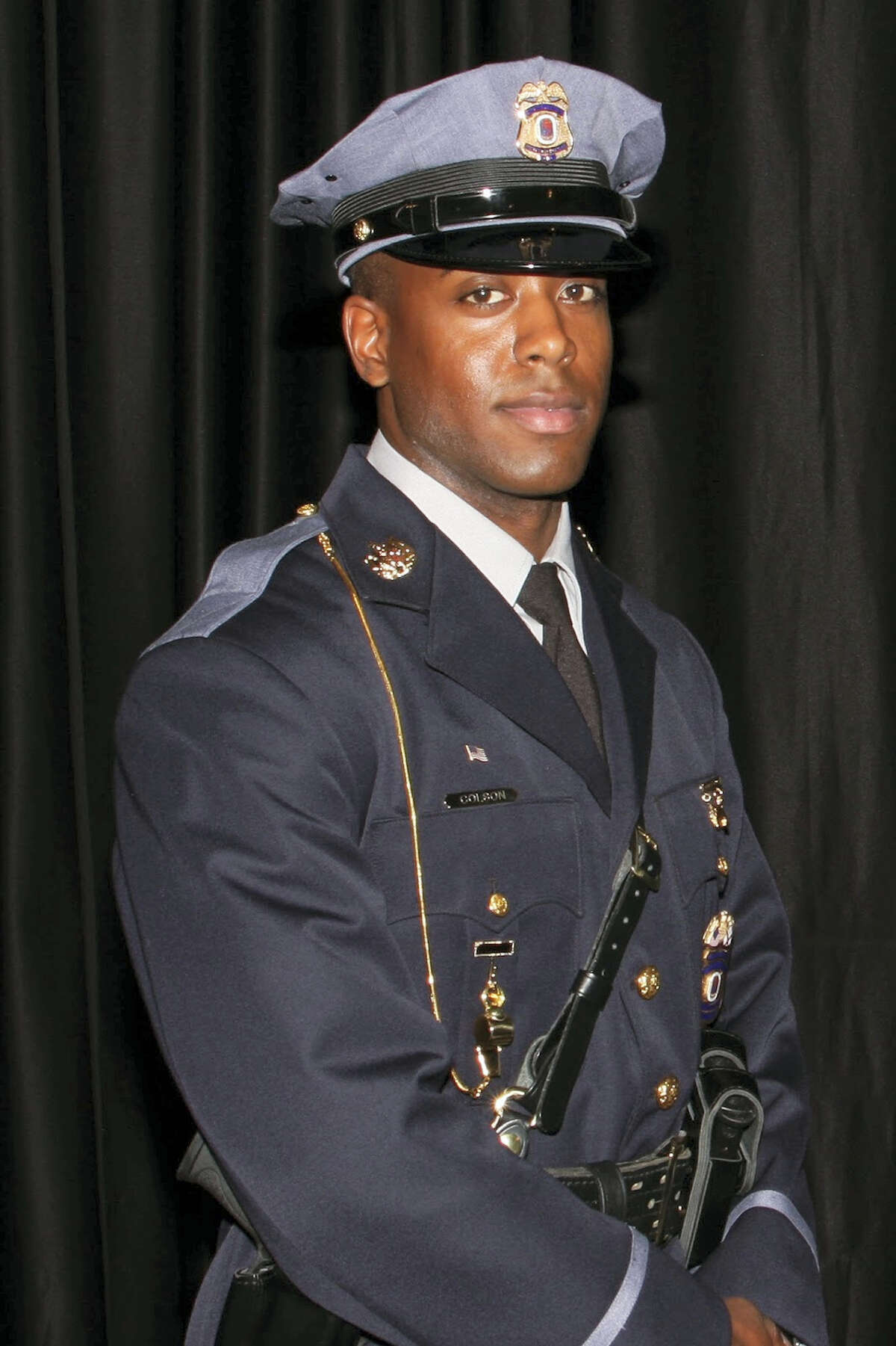 This undated photo provided by the Prince George's County Police Department shows officer Jacai Colson, a 4-year veteran of the Maryland county's police force. A gunman fired outside a Maryland police station on Sunday, March 13, 2016, prompting a gun battle that killed Colson and wounded the suspect, authorities said.