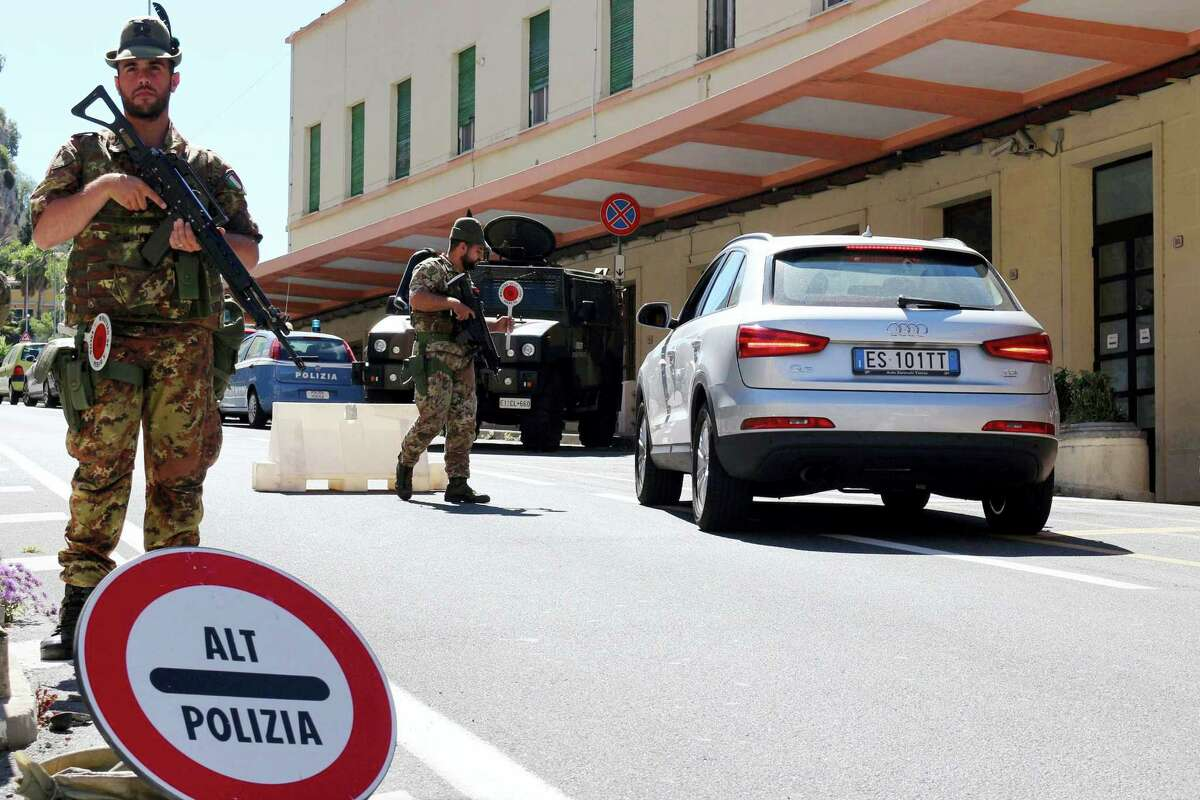 """A car is stopped by Italian Alpine Rangers at the border with France in Ventimiglia, Italy, Friday, July 15, 2016. Italy has told all local prefects and police chiefs to reassess their security measures and reinforce all """"sensitive targets"""" in the wake of the Nice truck attack."""