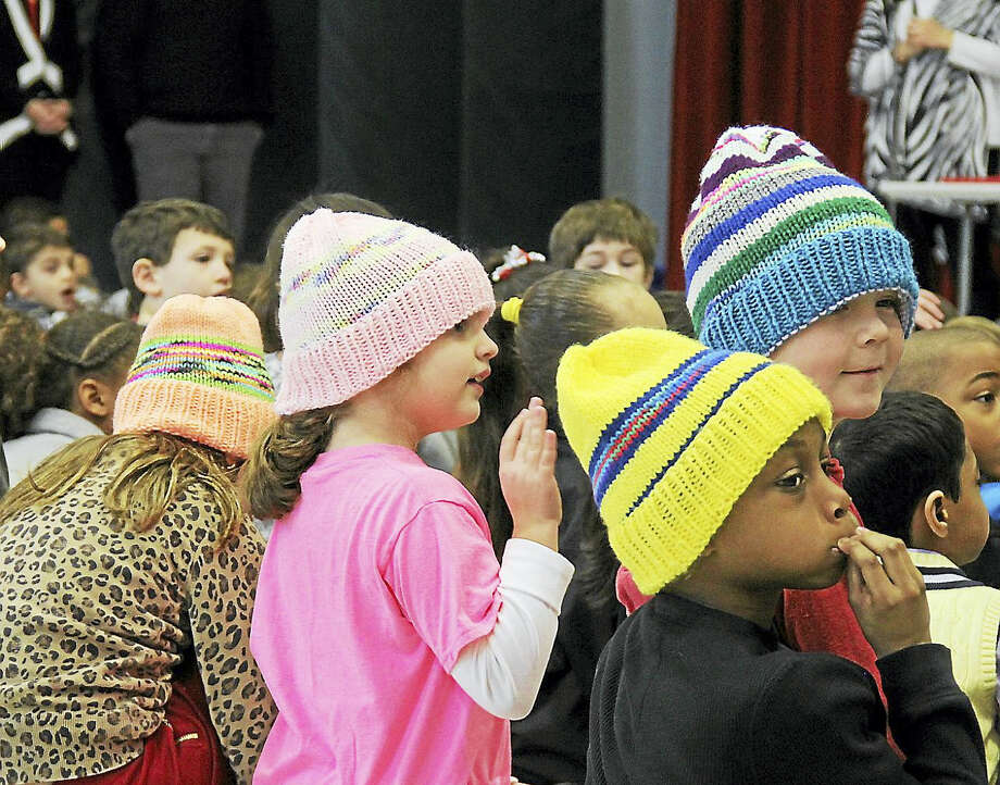 From left, students Gianna Salafia, Olivia Roy, Devin Morris and Isaiah Anderson don their colorful hats. Photo: Kathleen Schassler — The Middletown Press  / Kathleen Schassler All Rights