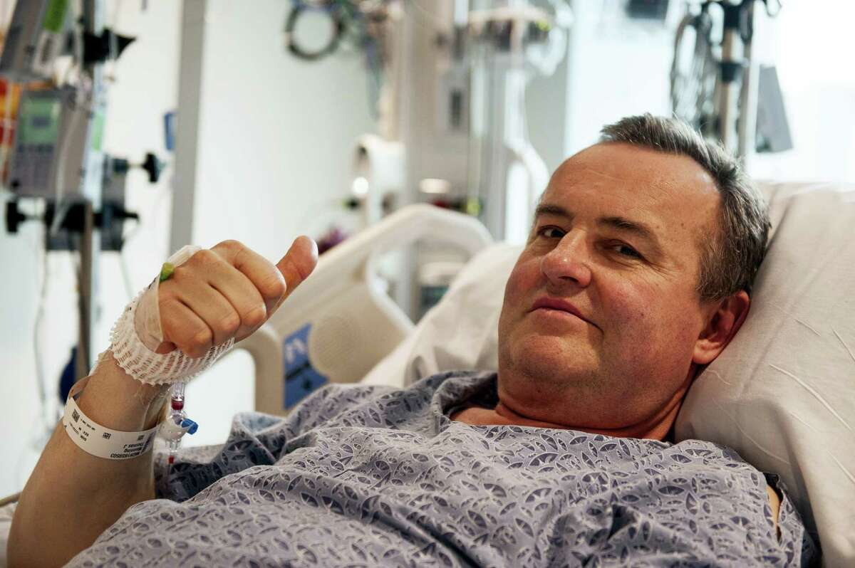 In this May 13, 2016 photo provided by Massachusetts General Hospital, Thomas Manning gives a thumbs up after being asked how he was feeling following the first penis transplant in the United States, in Boston. The organ was transplanted from a deceased donor.