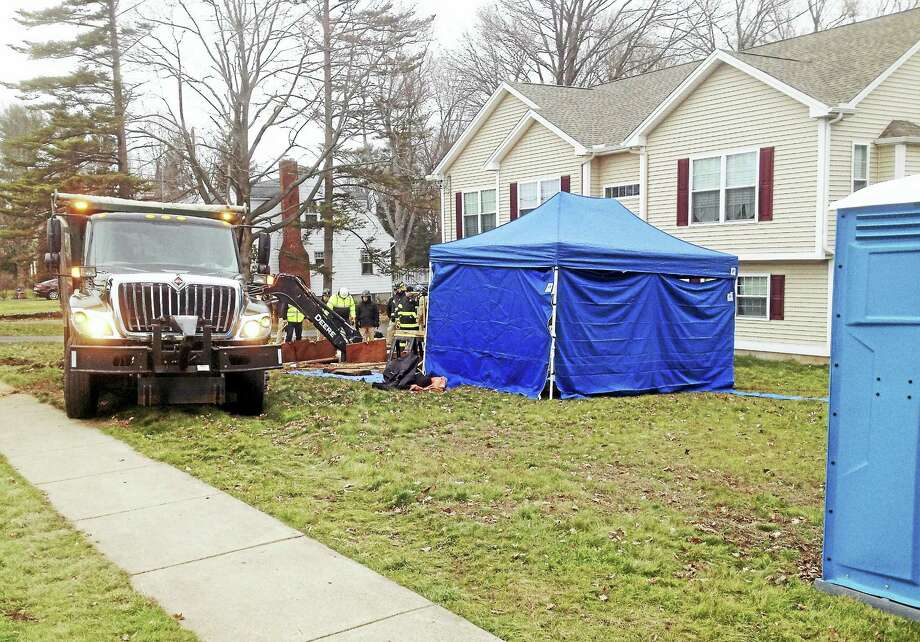 The FBI and local first-responders are excavating a Prospect Hill Road front yard in what is understood to be part of continuing search for the body of a missing 4-year-old girl. Photo: Jeff Mill — The Middletown Press