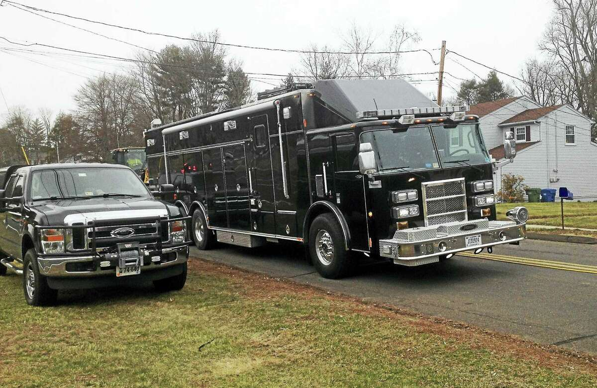 The team arrived in Cromwell late Monday afternoon in two large all-black trucks, one a tractor trailer truck, the other of a type that is often used a fire department command vehicle.