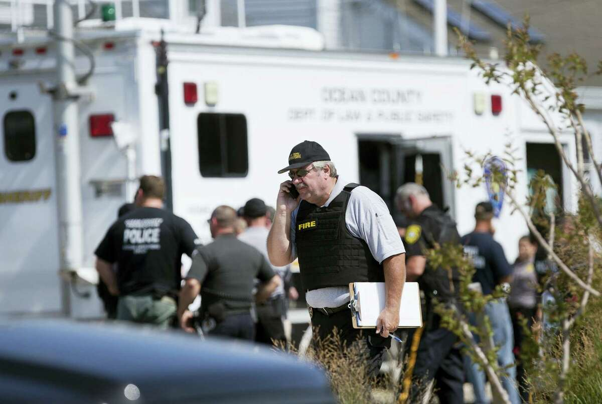 Police gather at a command center in Seaside Park, N.J., on Sept. 17, 2016 during an investigation of a pipe bomb which exploded before a charity race to benefit Marines and sailors. No injuries were reported.