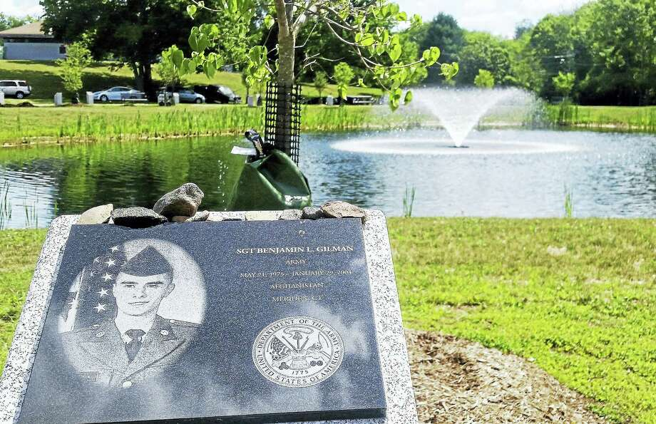 Stones are left by visitors on a granite memorial plaque for Sgt. Benjamin L. Gilman of Meriden, who died while in service of the U.S. Army in Afghanistan. Photo: Kathleen Schassler — The Middletown Press