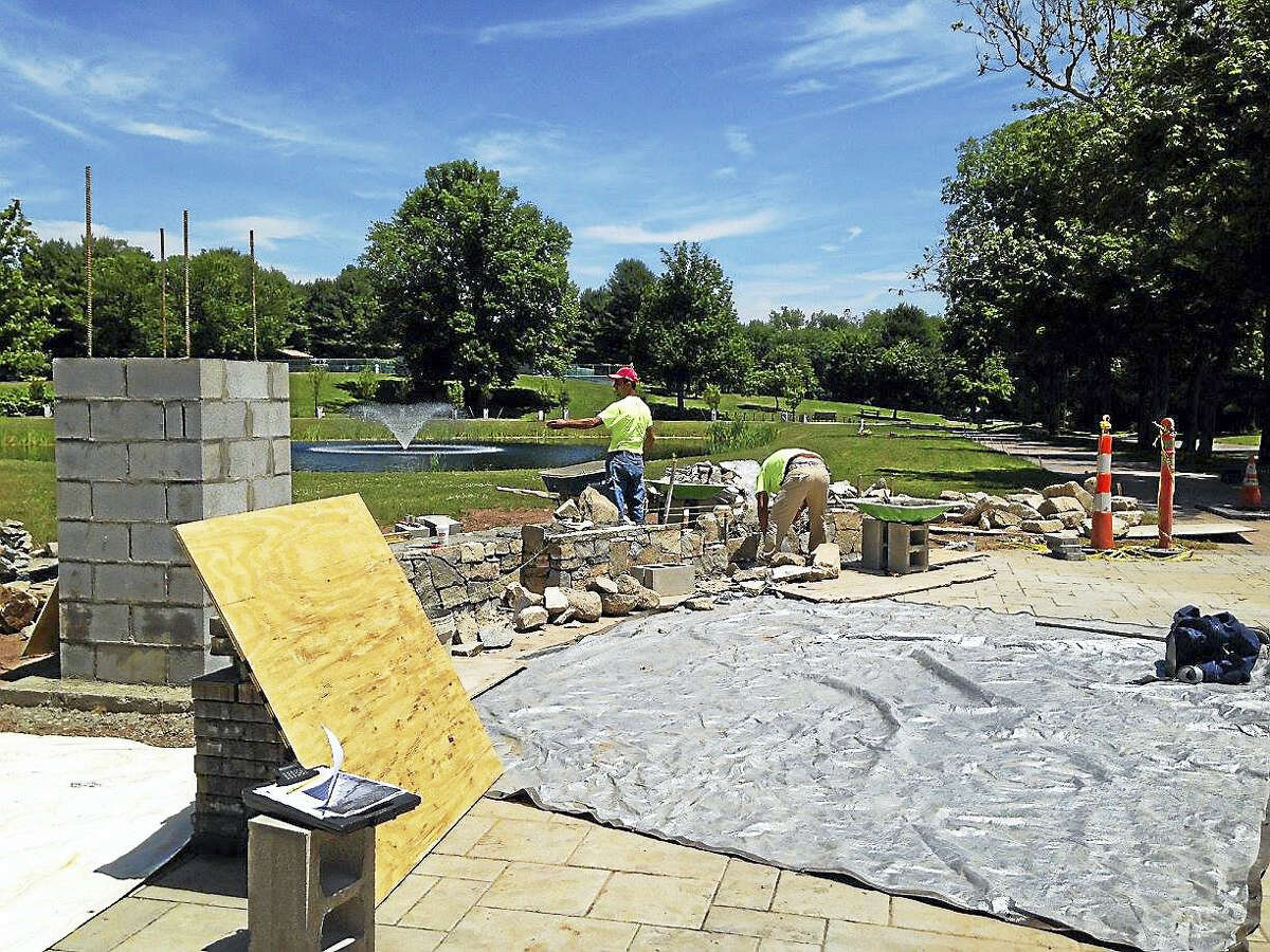 Work on a new plaza for the Trees of Honor Memorial continues by Connecticut Mason Contractors.