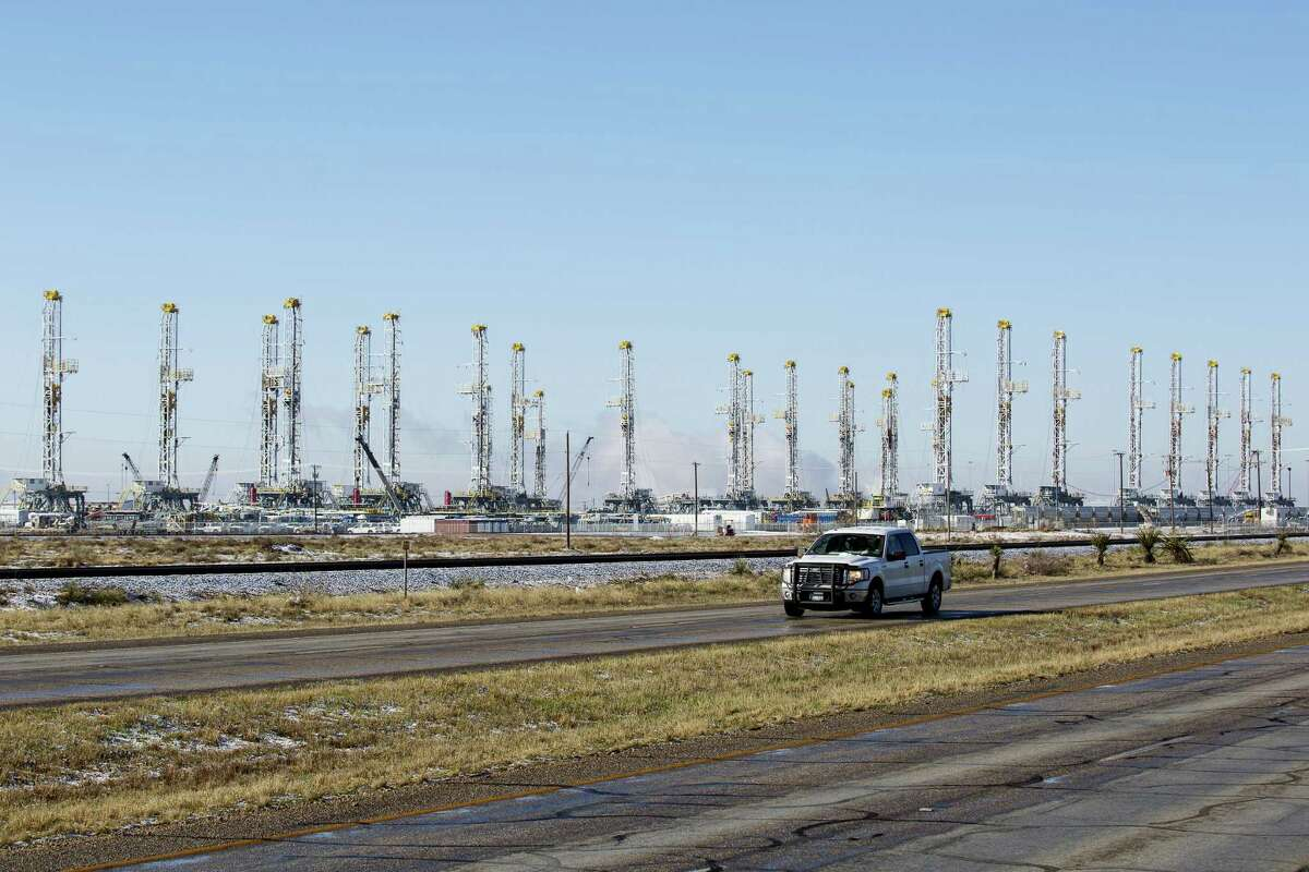 FILE - In this Wednesday, Feb. 25, 2015, file photo, more than 30 oil drilling rigs are idle in a Helmerich & Payne, Inc. yard in Odessa, Texas, along Highway 80, as rig counts drop in the Permian Basin. The price of oil continues to fall, extending a slide that has already gone further and lasted longer than most thought, and probing depths not seen since 2003. Lower crude prices are leading to lower prices for gasoline, diesel, jet fuel and heating oil, giving drivers, shippers, and many businesses a big break on fuel costs. But layoffs across the oil industry are mounting, and bankruptcies among oil companies are expected to soar.