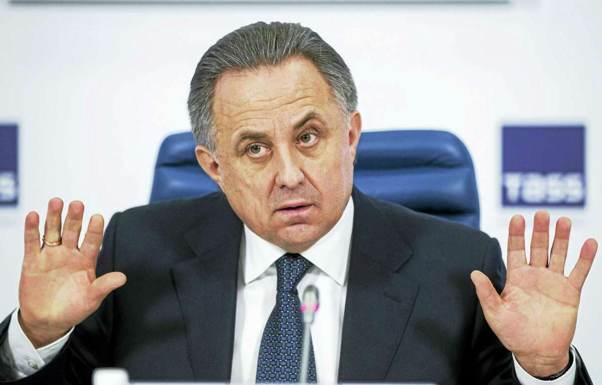 In this Dec. 25, 2015 photo, Russian Sports Minister Vitaly Mutko gestures during a news conference in Moscow, Russia. The International Association of Athletics Federations says a taskforce will visit Russia for the first time on Jan. 10-11, 2016 to inspect the response to the doping scandal which caused it to be banned from the sport.