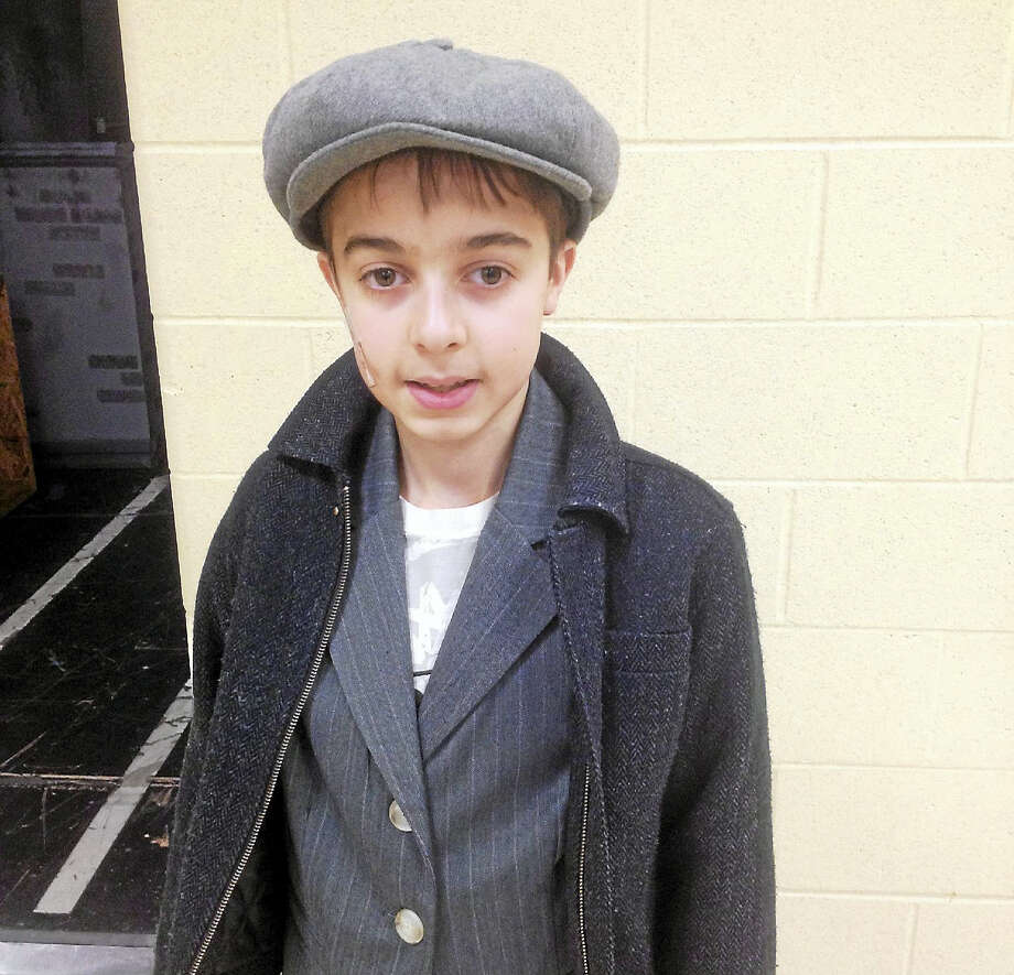 "Josh Aresco dresses the part during rehearsals for ""Mary Poppins."" Photo: Jeff Mill — The Middletown Press"