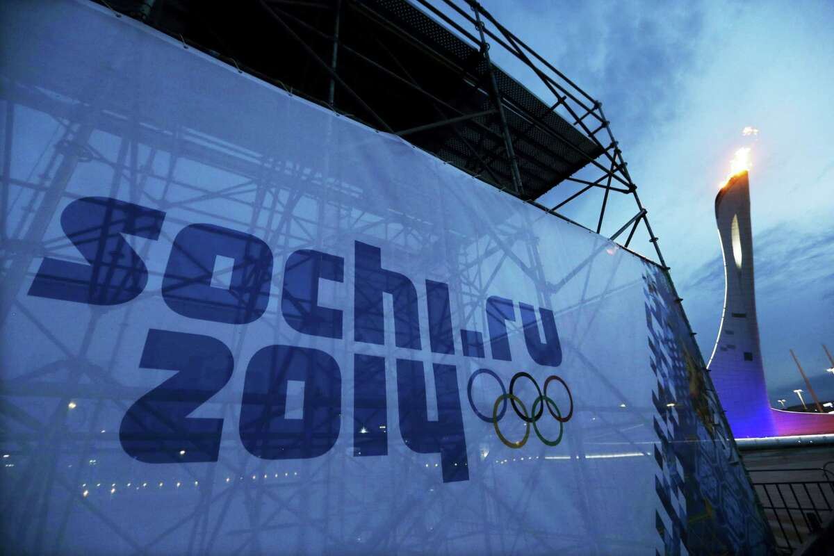 The Olympic torch is tested before the start of the 2014 Winter Olympics in the Olympic Park in Sochi, Russia.