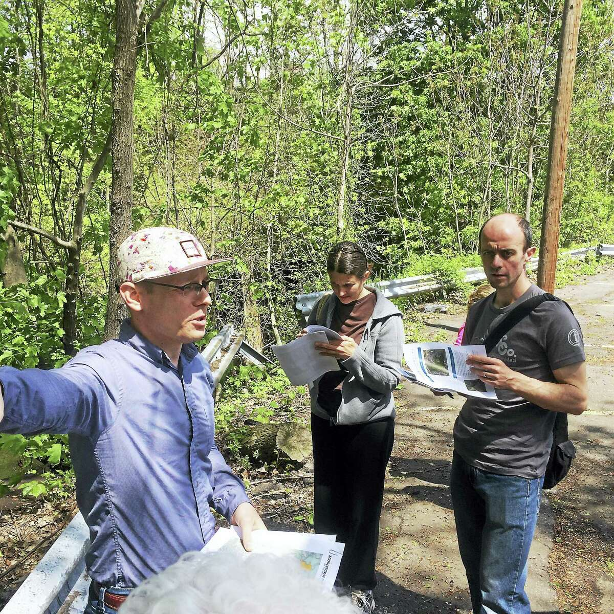 Jeff Davis of the Horsley Witten Group speaks to members of a bus tour on Saturday near Sumner Brook at rear of the parking lot of the city's former Social Services office on Main Street Extension.
