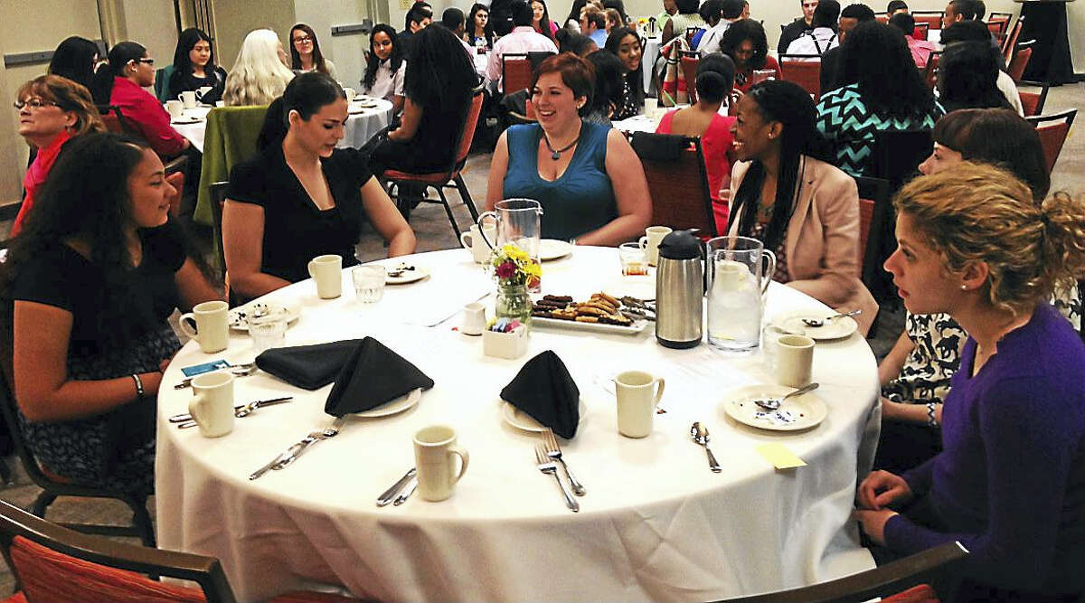 From left are Gabriela Montanez, a ninth grader at Middletown High School; and Wesleyan University seniors Shelby Harper, Trinithas Boyi, Jennifer Cummings and Elizabeth Paquette at the etiquette luncheon at the Marriott in Cromwell.
