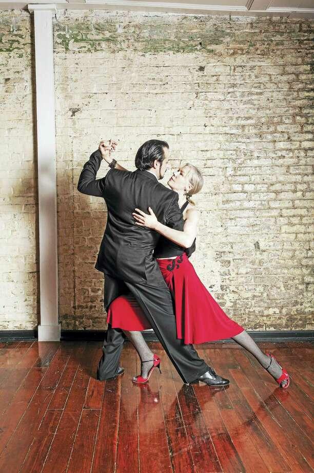 It's tango time for Gem Duras, left, and Dale Ellison. Photo: Photo Courtesy Of Milford Art Center  / G.LAMBTON-CARR