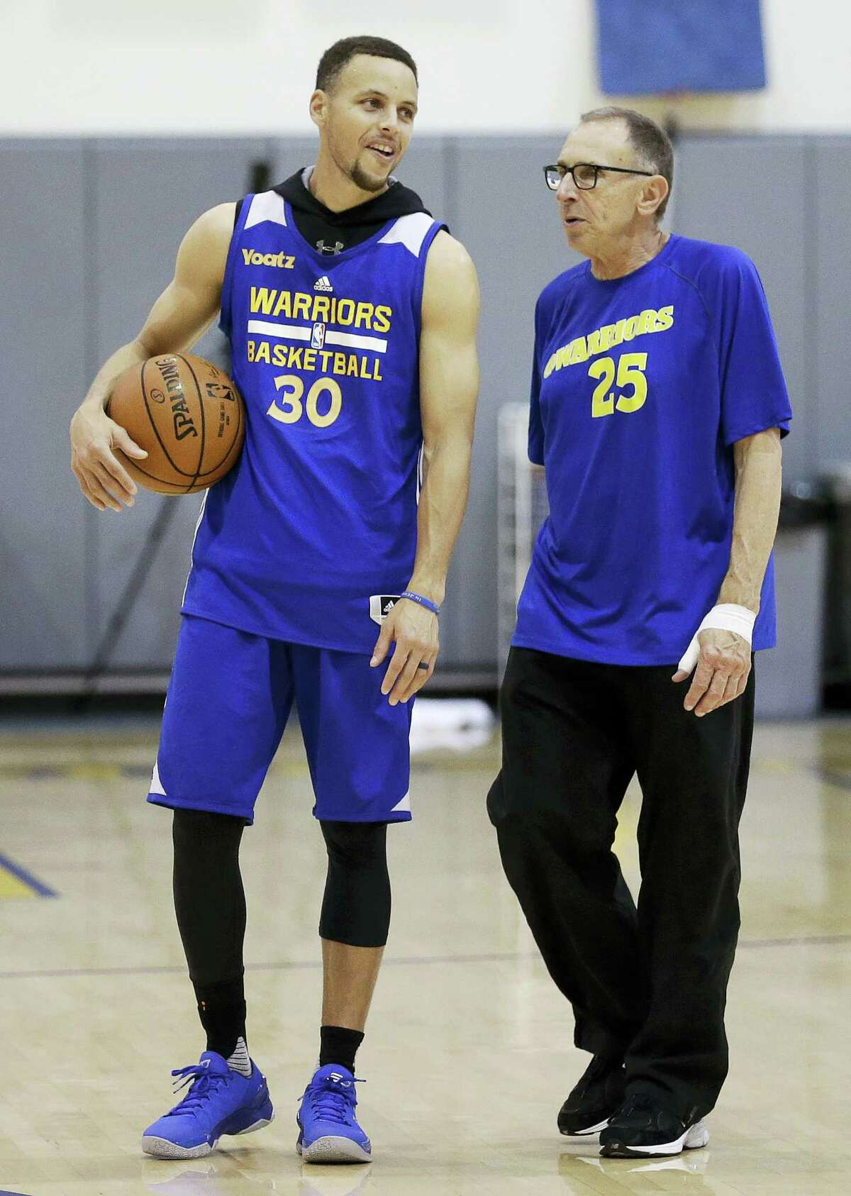 Stephen Curry, left, speaks with assistant coach Ron Adams during a recent practice. The Warriors play the Oklahoma City Thunder in Game 1 of the Western Conference finals on Monday.