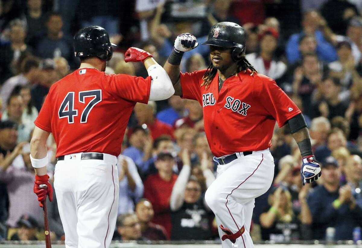 Boston's Hanley Ramirez, right, celebrates his solo home run with Travis Shaw (47) during the fourth inning against the New York Yankees in Boston, Friday.