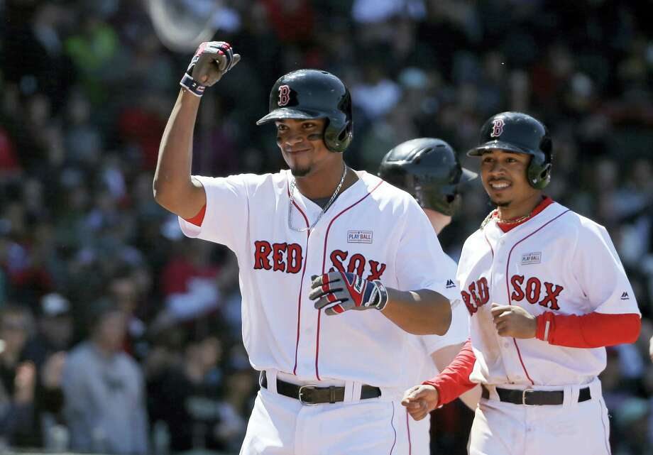 Xander Bogaerts, left, celebrates his three-run home run in the second inning Sunday against the Astros. Photo: Steven Senne — The Associated Press  / Copyright 2016 The Associated Press. All rights reserved. This material may not be published, broadcast, rewritten or redistribu