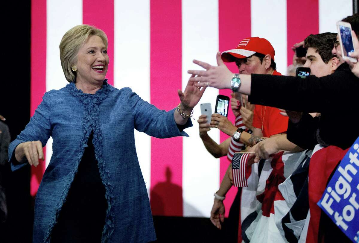 Democratic presidential candidate Hillary Clinton arrives to a cheering crowd at an election night event Tuesday at the Palm Beach County Convention Center in West Palm Beach, Fla.