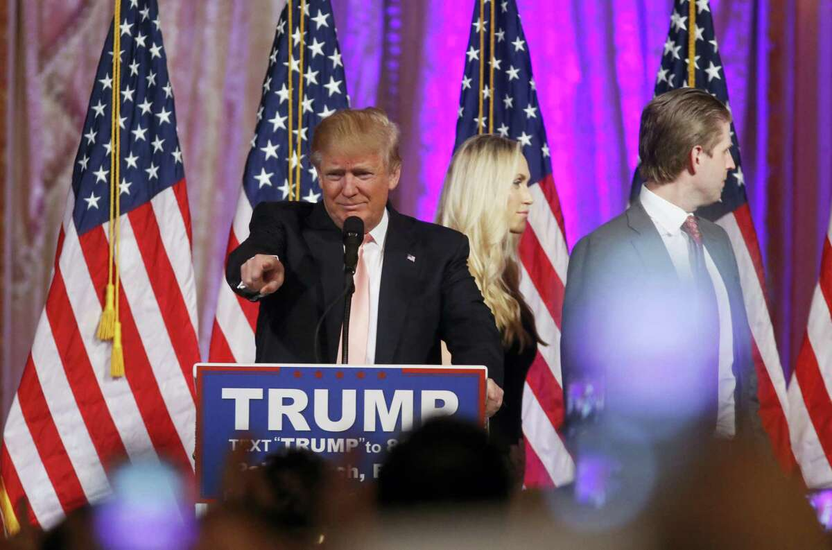 Republican presidential candidate Donald Trump arrives to speak to supporters Tuesday at his primary election night event at his Mar-a-Lago Club in Palm Beach, Fla. Behind is his son Eric Trump and Eric's wife Lara Yunaska.