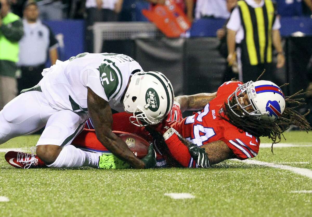 New York Jets wide receiver Brandon Marshall (15) is injured while being tackled by Buffalo Bills cornerback Stephon Gilmore (24) during the first half Thursday.