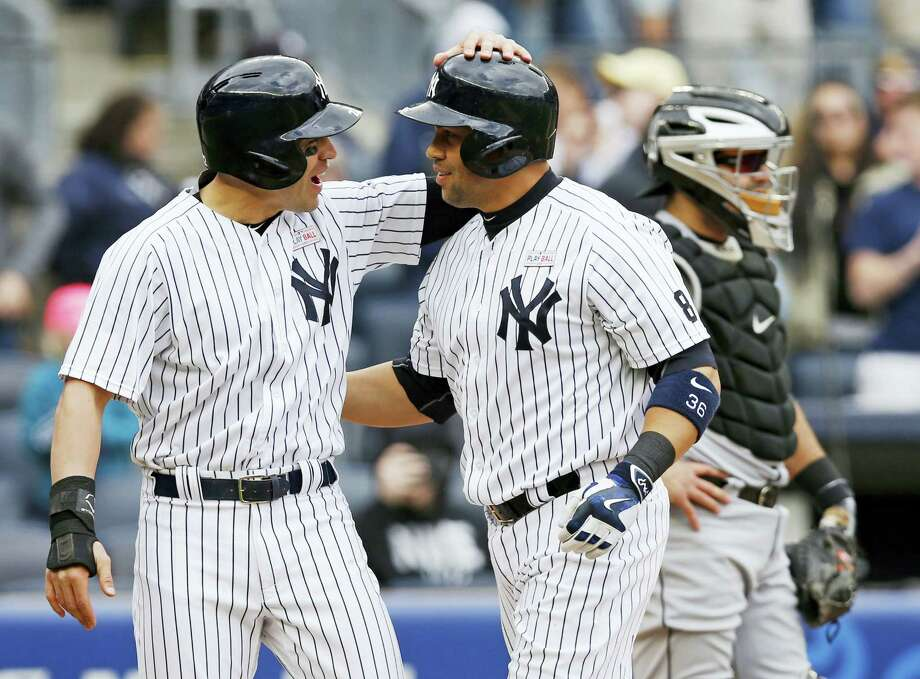 Jacoby Ellsbury, left, congratulates Carlos Beltran on hitting his 400th career home run during the sixth inning on Sunday. Photo: Kathy Willens — The Associated Press  / Copyright 2016 The Associated Press. All rights reserved. This material may not be published, broadcast, rewritten or redistribu