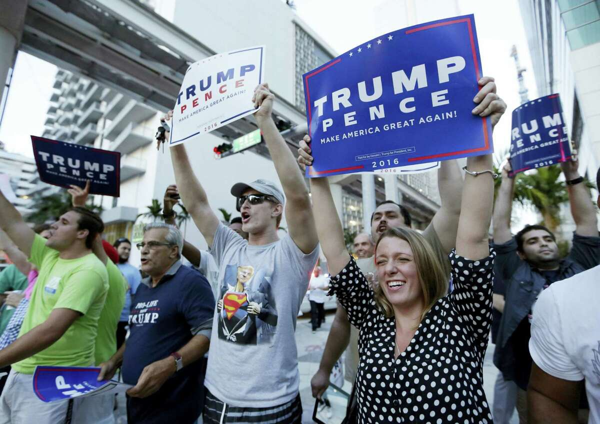 Supporters of Republican presidential candidate Donald Trump wave signs