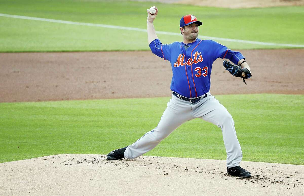 New York Mets' starting pitcher Matt Harvey delivers the ball during the first inning against the Miami Marlins Sunday in Jupiter, Fla.