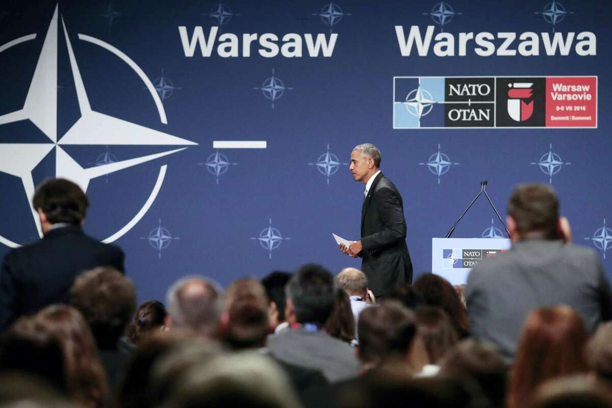 United States President Barack Obama leaves after a news conference at the NATO summit in Warsaw, Poland, July 9.