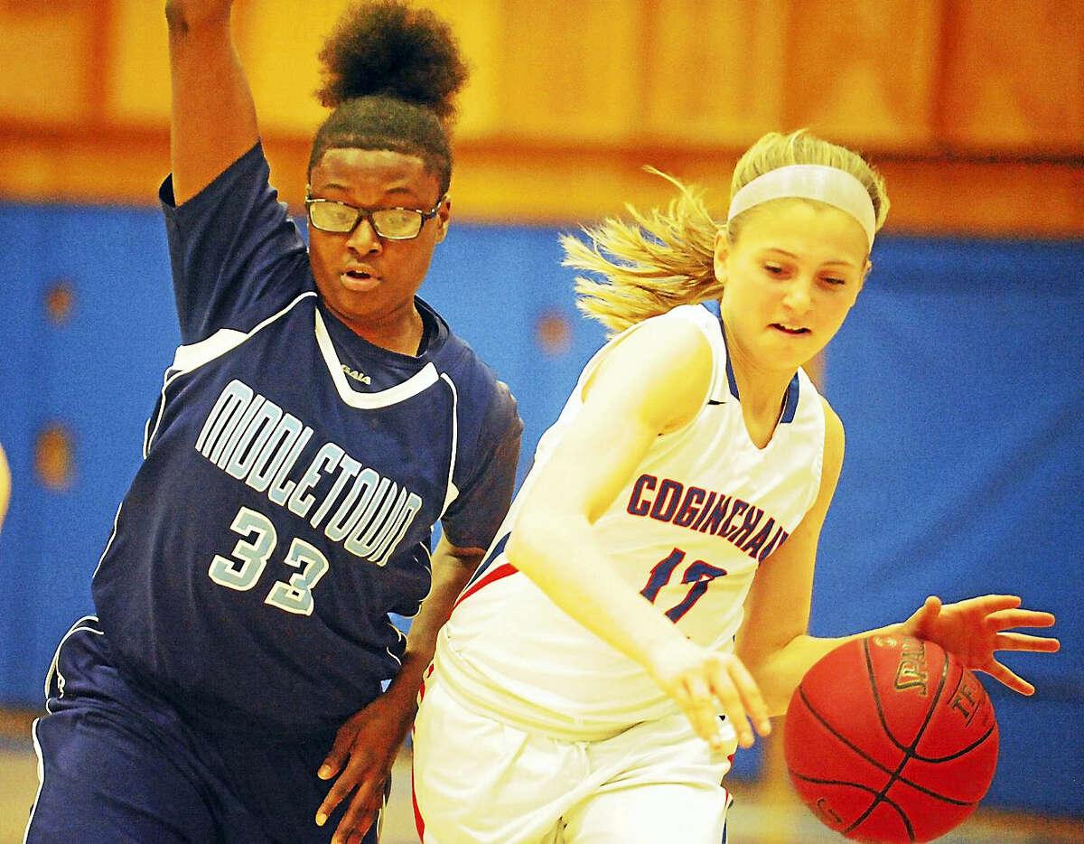 Coginchuag junior Bridget Turecek pushes the ball upcourt as Middletown senior Nakazja Holley defends this weekend in Durham.