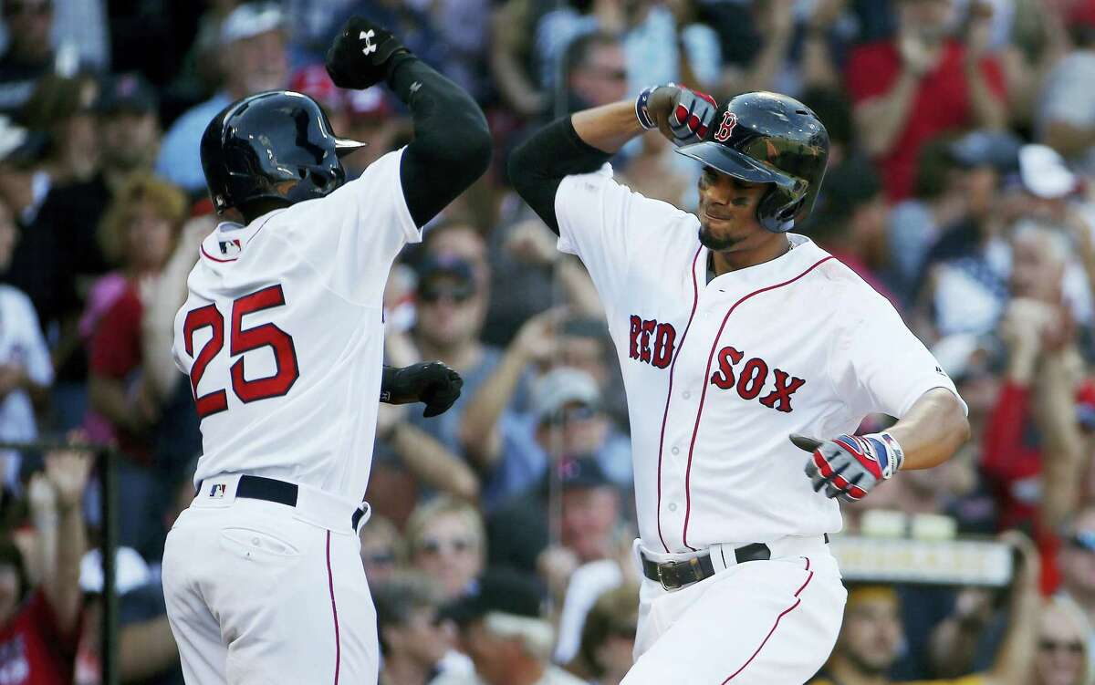 Boston Red Sox's Xander Bogaerts, right, celebrates his two-run home run that also drove in Jackie Bradley Jr. (25) during the fifth inning of a baseball game against the New York Yankees in Boston, Saturday, Sept. 17, 2016. (AP Photo/Michael Dwyer)