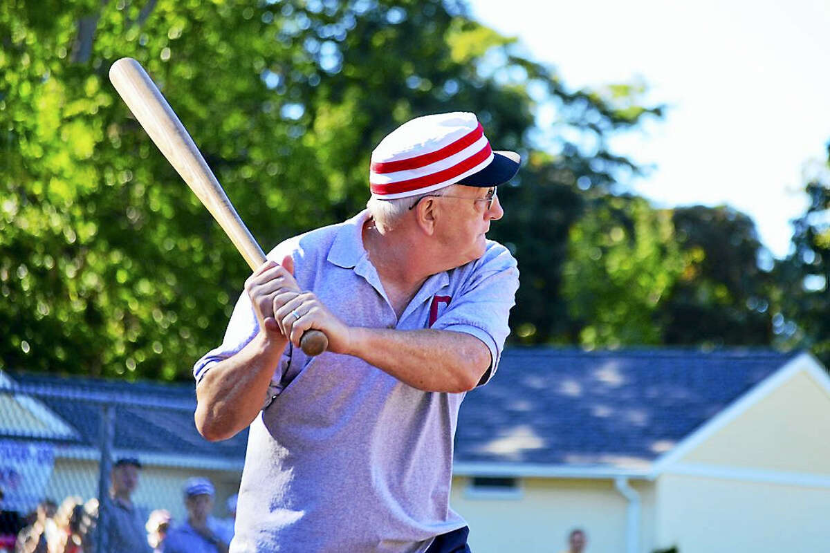 """Caption: On Sunday, Sept. 18 at 2 p.m., three teams will face off in the 3rd Annual Vintage Base Ball Game presented by the Chester, Deep River and Essex Historical Society at Devitt Field in Deep River. In this free, family-friendly event, the teams will be playing base ball by the rules of the year 1857 (when """"baseball"""" was spelled as two words), using replica bats and balls from the 1900s and wearing reproduction uniforms. Bring a chair to supplement bleacher seating. Raindate is Sept. 25. More info at Facebook.com/ChesterCTHistoricalSociety. Shown here is Marty (""""Moe Larry Curly"""") Radomski of the Deep River Haz Beenz, in last year's game, which Deep River won. (Skip Hubbard photo)"""