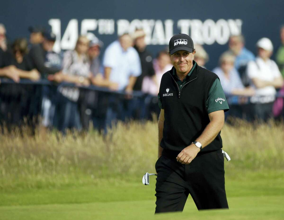 Phil Mickelson of the United States smiles as he walks onto the 18th green during the first round of the British Open Golf Championship at the Royal Troon Golf Club in Troon, Scotland, Thursday, July 14, 2016. (AP Photo/Matt Dunham)