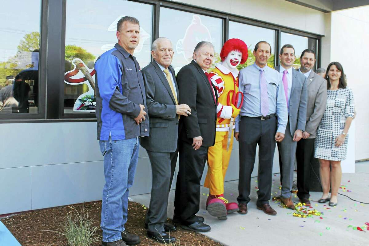 McDonald's at 30 Shunpike Road in Cromwell held a grand reopening celebration May 12. Shown from left are: chairman of the Cromwell Downtown Merchants Association Rodney Bitgood, chamber president Larry McHugh, chamber Cromwell Division chairman Jay Polke, Ronald McDonald, co-owners Nick Haskos and John Haskos, Cromwell Mayor Enzo Faienza and state. Rep. Christie Carpino.