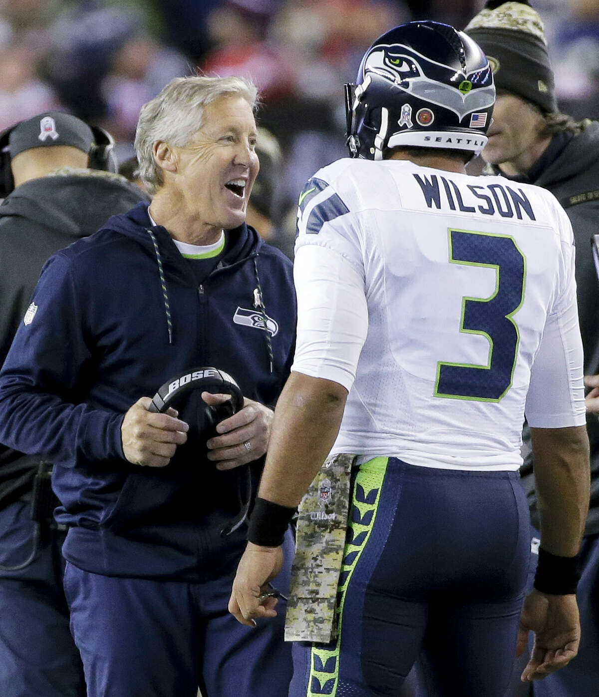 Seattle Seahawks head coach Pete Carroll, left, and quarterback Russell Wilson celebrate Wilson's touchdown pass to Doug Baldwin during the first half of an NFL football game against the New England Patriots on Sunday, Nov. 13, 2016 in Foxborough, Mass.