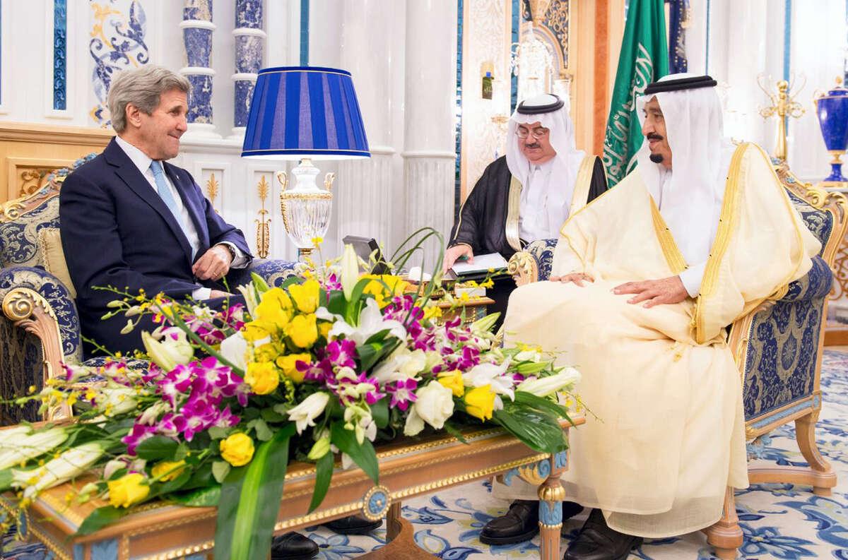 In this May 15, 2016 photo released by the Saudi Press Agency, SPA, Saudi Arabia King Salman bin Abdul Aziz, right, meets with U.S. Secretary of State John Kerry in Jiddah, Saudi Arabia.