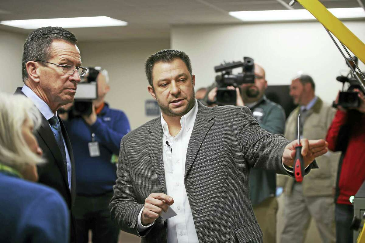 Gov. Dannel P. Malloy and Brian Maontanari, president and CEO of HABCO Industries during a tour of the facility Monday.