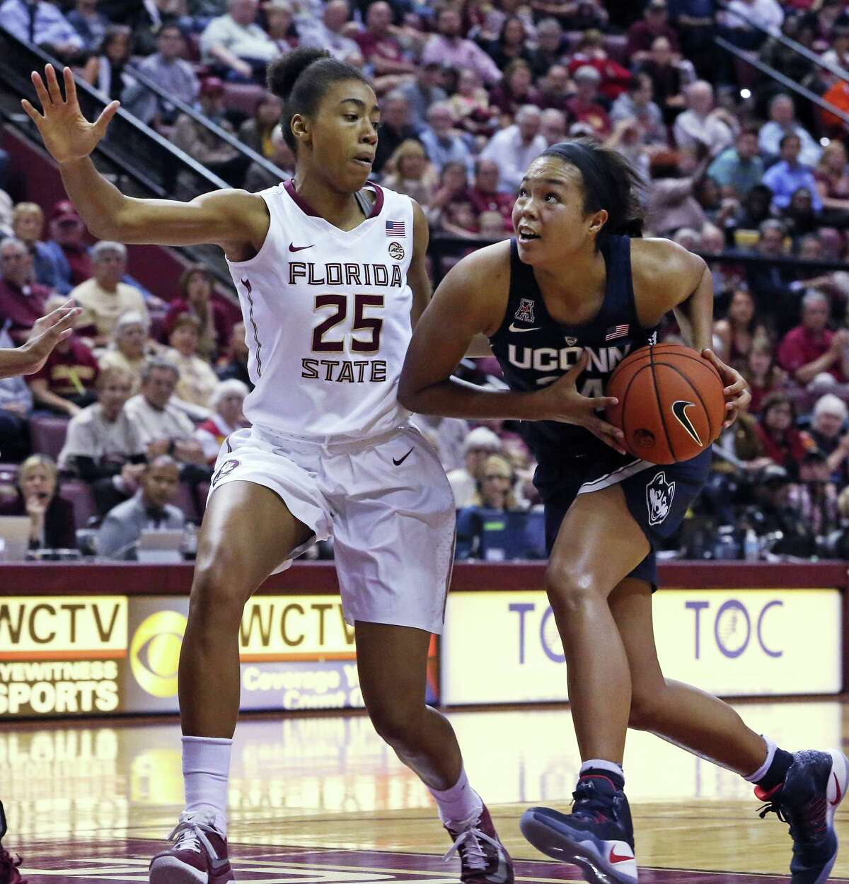 Connecticut's Napheesa Collier drives to the basket as Florida State's Ama Degbeon defends in the second quarter of an NCAA college basketball game, Monday, Nov. 14, 2016, in Tallahassee, Fla. UConn won the game 78-76. (AP Photo/Steve Cannon)