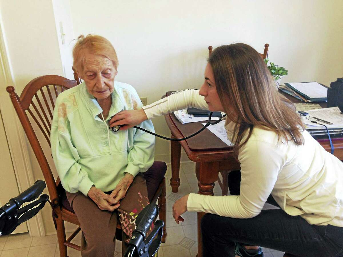 Florence Jamieson, 95, meets with Darcy Ingres, a registered nurse who works with the Farmington Valley Visiting Nurse Association, at Jamieson's home in Farmington. The agency received an overall four-star rating.