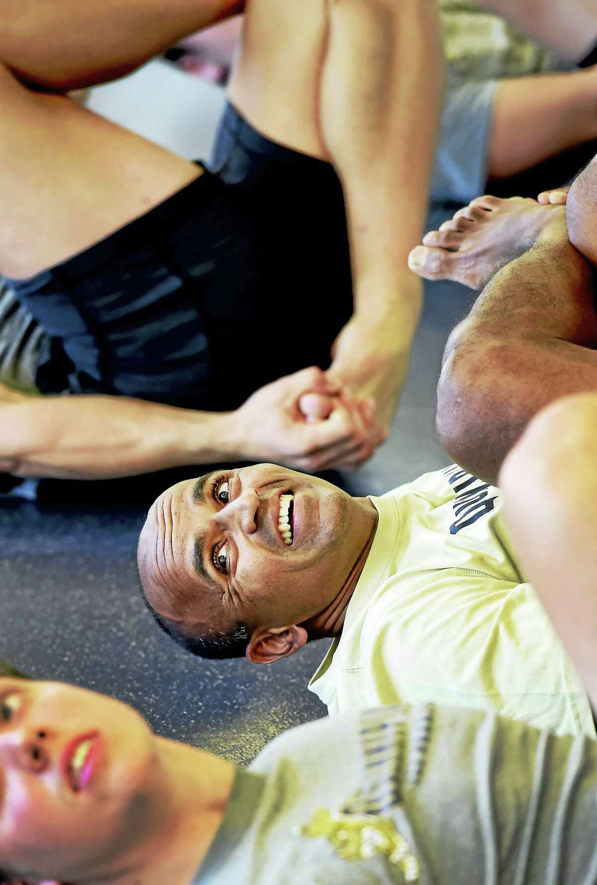 Brijesh Patel leads Quinnipiac hockey players in a stretching and relaxation exercise Wednesday.