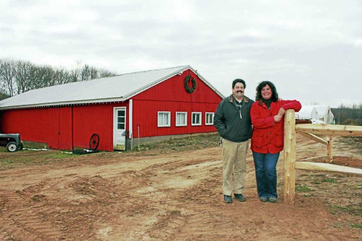 Christine Whitney works with her husband, John, at the Phoenix Farm.