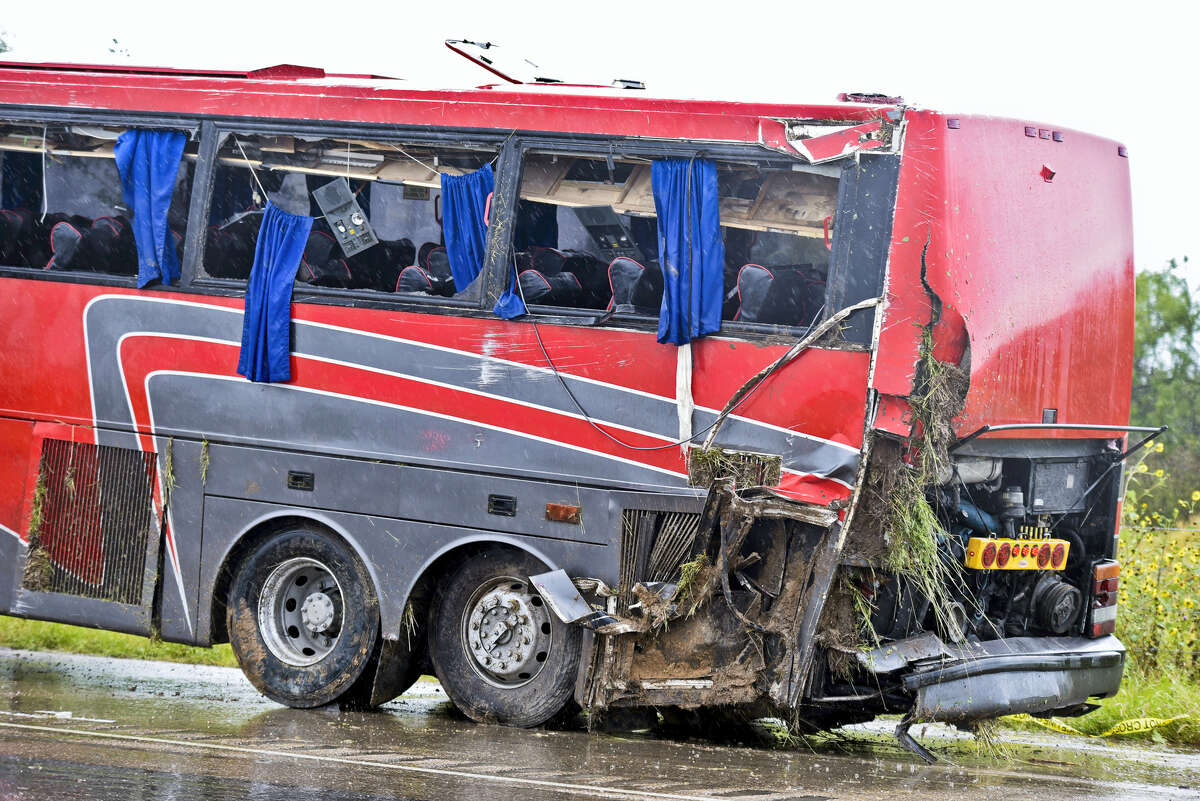 A damaged OGA Charters bus is hauled away after a fatal rollover on May 14, 2016 south of the Dimmit-Webb County line on U.S. 83 North in Texas.
