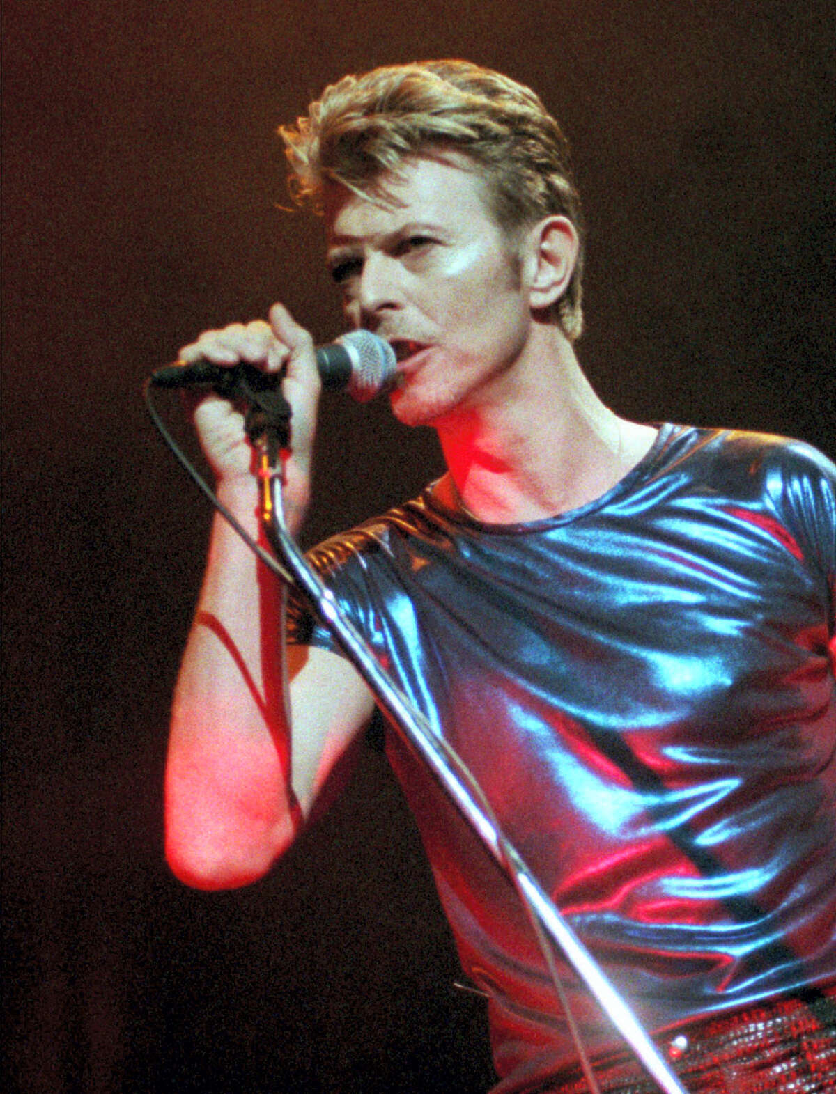 FILE - In this Sept. 14, 1995, file photo, David Bowie performs during a concert in Hartford, Conn. Bowie, the innovative and iconic singer whose illustrious career lasted five decades, died Monday, Jan. 11, 2016, after battling cancer for 18 months. He was 69. (AP Photo/Bob Child, File)