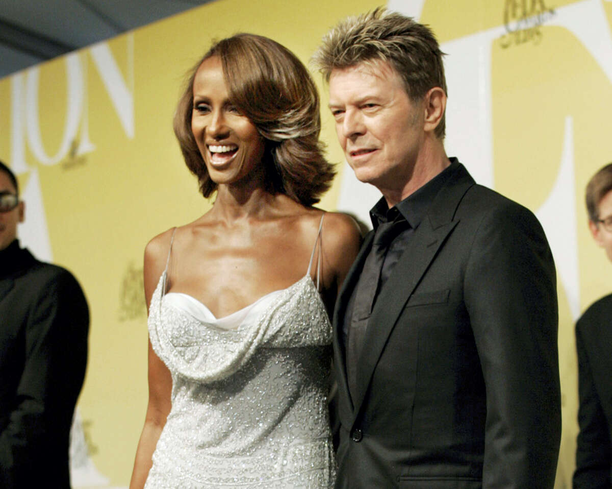 FILE - In this June 6, 2005 file photo, singer David Bowie and his wife Iman pose at the 2005 CFDA Fashion Awards in New York. Bowie, the innovative and iconic singer whose illustrious career lasted five decades, died Monday, Jan. 11, 2015, after battling cancer for 18 months. He was 69 (AP Photo/Stuart Ramson, File)